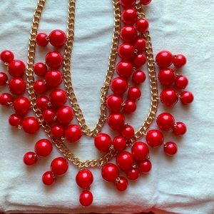 Beautiful red necklace with earrings to match.